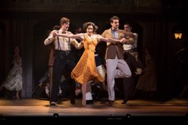 Caroline Bowman as 'Eva' and the cast in the National Tour of EVITA. Photo by Richard Termine